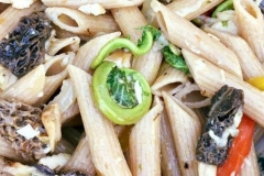 Fiddleheads in pasta primavera